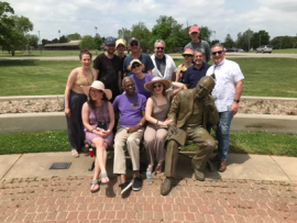 George Nelson at the Inge New Play Festival with the statue of Inge, Carlyle Brown (front row, purple shirt), and other playwrights at the festival.