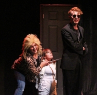 The Evil Angel (Michael Baliff, left) and Mephistopheles (Ian Buckley) hiding the Good Angel (Emma Nulton).