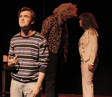 Faustus (Caleb Andrus, left) wondering what to do while the Evil Angel (Michael Baliff, center) and the Good Angel (Emma Nulton, right) fight over his soul.