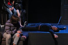 Sloth (Jared Kamauu) rolling over to speak with Faustus (Caleb Andrus)