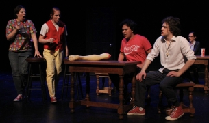 From left to right, Dick (Chelsea Mortensen), Robin (Sarah McDonald), Martino (Michael Avila), Benvolio (Josh Bauer), & Wagner (Hannah Staley-Foster) look at Faustus's leg.