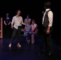 Benvolio (Josh Bauer, front left) laughs at Faustus (Caleb Andrus, front right), while the Emperor (Braxton Church, center) and the Lady (Miranda Maynard, center) watch in horror, all the while Mephistopheles (Ian Buckley, back left) is indifferent.