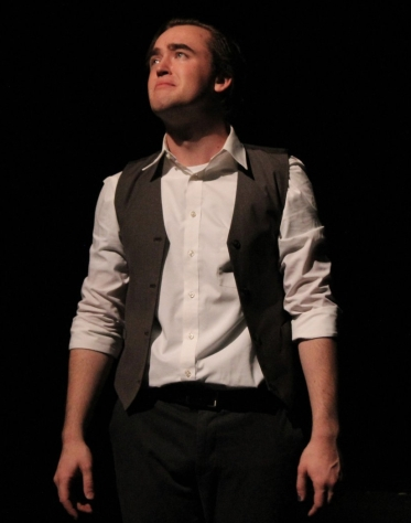 Faustus (Caleb Andrus) laments the life he wasted away.